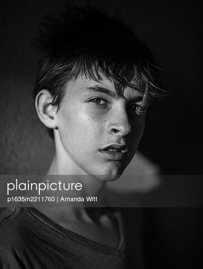 Boy in shadow - p1635m2211760 by Amanda Witt