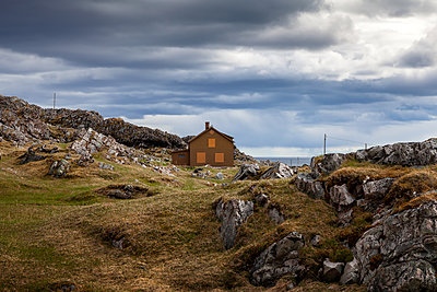 House between rocks at the Barents Sea - p1168m1563602 by Thomas Günther