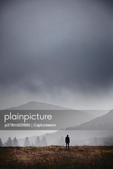 Lone figure on moor - p378m920889 by  Captureworx