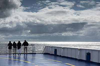 Four people on a ferry - p1354m2285020 by Kaiser