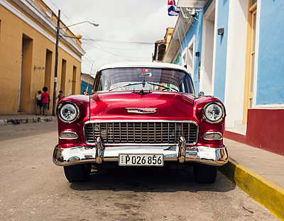 Red car in Trinidad, Cuba - p1515m2101069 by Daniel K.B. Schmidt