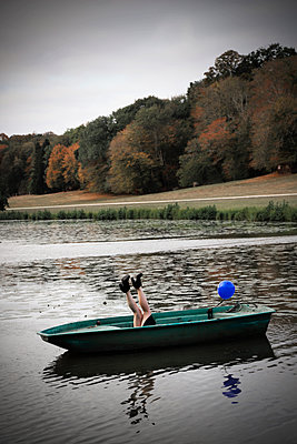 Woman's legs in a boat - p1521m2214989 by Charlotte Zobel