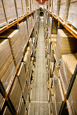 Warehouse filled with stacked pallets of cardboard boxes, elevated view - p62320016f by James Hardy