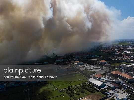 Indonesia, Bali, Aerial view of Sanur, smoke - p300m2042644 by Konstantin Trubavin