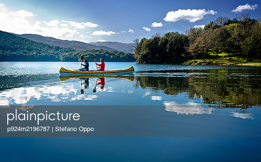 Couple canoeing on Gusana lake, an artificial lake in the territory of Gavoi, Sardinia, Italy.  - p924m2196787 by Stefano Oppo