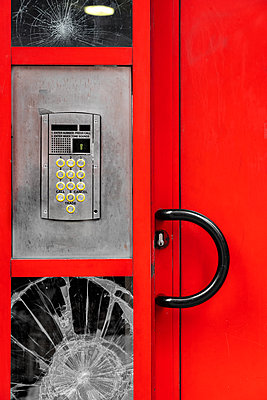 Intercom and broken glass on front door - p1280m2182472 by Dave Wall