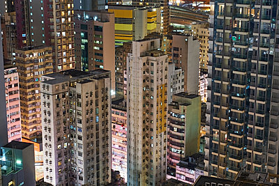Lighted apartment towers, Kowloon, Hong Kong, China - p300m2121745 by Michael Reusse (alt)