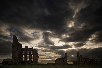Tynemouth priory under dark storm clouds;Tynemouth tyne and wear england - p442m837648f by John Short