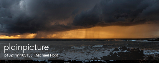 Thunderstorm clouds over Pacific Ocean  - p1324m1165155 by michaelhopf