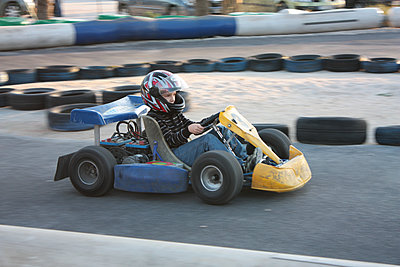 Driving on a kart track - p1105m2063831 by Virginie Plauchut