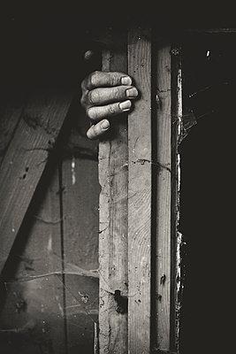 Hand on window frame - p1621m2278152 by Anke Doerschlen