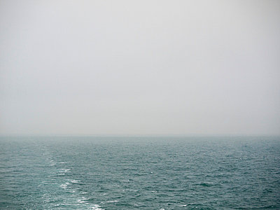 Misty seascape from ferry - p388m702070 by Andre