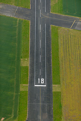 Aerial view of airport runway  - p1048m2088107 by Mark Wagner