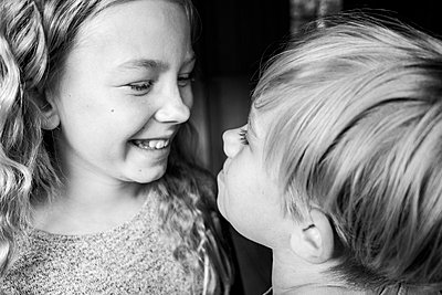 Brother and sister laughing together - p312m2280505 by Sara Winsnes