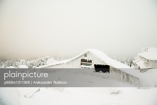 Weather station on snowy remote mountain