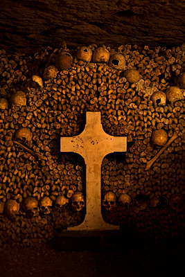 Catholic cross, Catacombs of Paris, France - p1028m2164175 by Jean Marmeisse