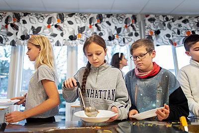 Children choosing food in school canteen - p312m2191279 by Scandinav