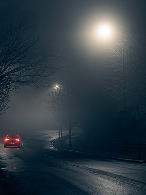 Car in fog - p1280m2152529 by Dave Wall