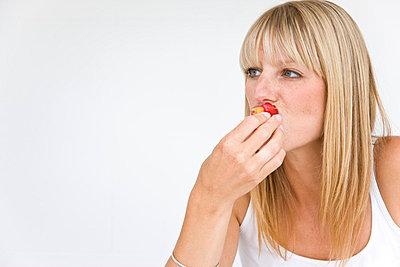 Woman Eating - p6691860 by David Harrigan