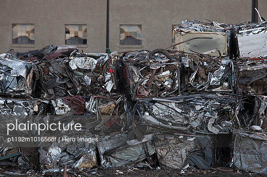 Compressed trash in a row - p1192m1016568f by Hero Images