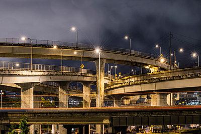 View of multiple lane highway against sky - p1166m1489338 by Cavan Images