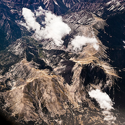 Mountain range and clouds aerial view - p1492m2037283 by Leopold Fiala