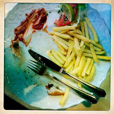 Remains of schnitzel with fries in Freiburg im Breisgau, Baden-Wuerttemberg, Germany - p300m1010212 by Heinz Linke