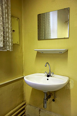 Old lavatory with washbasin - p300m879480 by Tom Hoenig