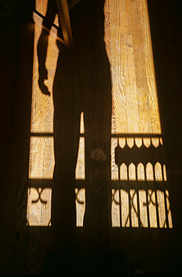 Silhouette of man on timber flooring - p873m2196010 by Philip Provily