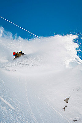 Snowboarder makes a powder turn, Innsbruck, Tyrol, Austria - p1026m827707f by Hans Herbig