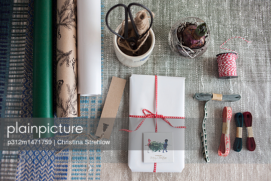 Wrapped present on table - p312m1471759 by Christina Strehlow