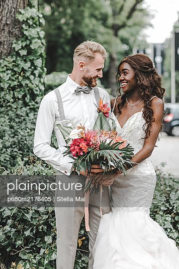 Mult-ethnic wedding couple - p680m2176405 by Stella Mai