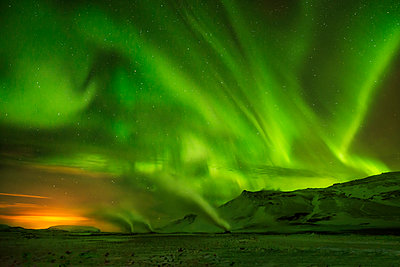 Scenic view of aurora borealis over mountains - p1166m1176301 by Cavan Images