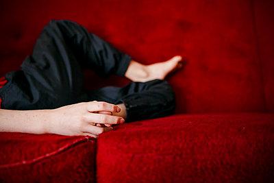 Hand on sofa - p312m2091538 by Matilda Holmqvist