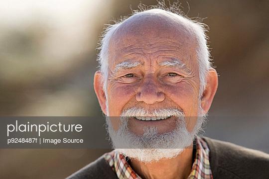 Smiling senior man - p9248487f by Image Source