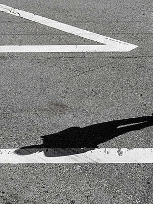 Shadow of man on the road - p1280m1439932 by Dave Wall