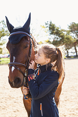 Teenage girl and a horse in Sweden - p352m2040615 by Serny Pernebjer