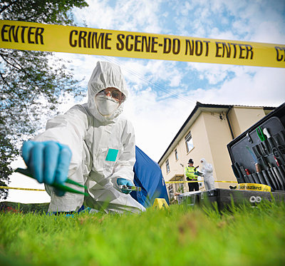Forensic scientist at crime scene - p429m711794f by Monty Rakusen