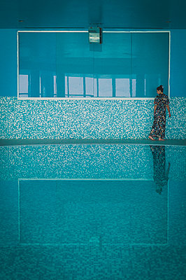 Woman in indoor swimming pool - p1150m2134463 by Elise Ortiou Campion
