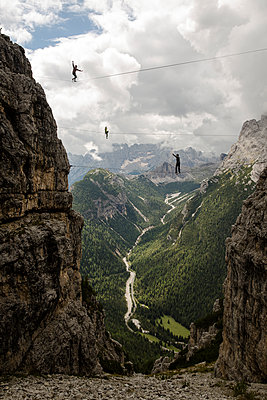 Three highliners in the dolomites, Italy - p343m1107144 by Sebastian Wahlhuetter