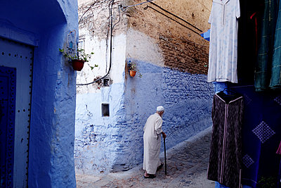 Old man walking in old town - p1189m1222215 by Adnan Arnaout