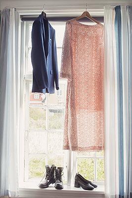 Clothes in a window - p1323m2015556 von Sarah Toure
