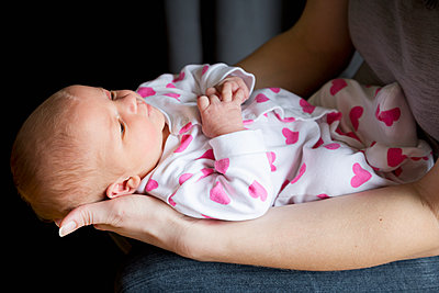 A mother holds her newborn baby daughter; Chilliwack, British Columbia, Canada - p442m1085198f by Lorna Rande