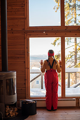 Teenage girl in log cabin - p312m1180479 by Juliana Wiklund