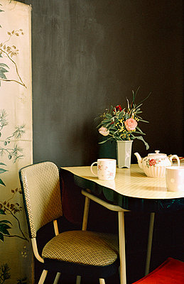 Kitchen dining table and chair with crockery - p349m695127 by Emma Lee