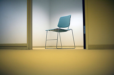 Empty chair in office - p3721916 by James Godman