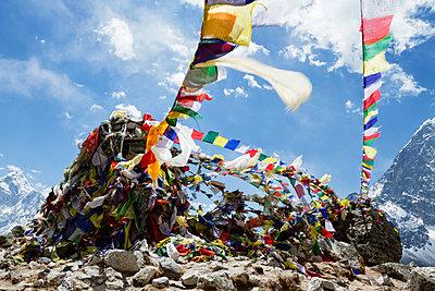 Prayer flags hanging on Mt. Everest against sky - p1166m1151444 by Cavan Images