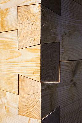 Close up of dovetail wooden corner of built structure - p301m2018708 by Halfdark