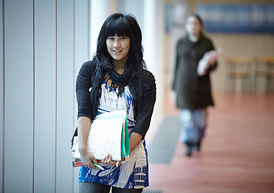 Girl standing in corridor - p528m718658f by Morgan Karlsson