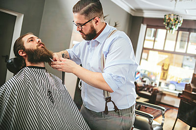 Barber cutting beard of a customer - p300m1053004f by Matthias Drobeck
